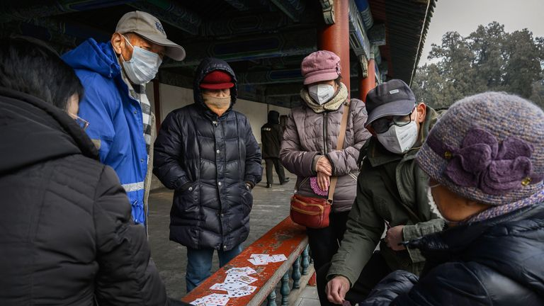 BEIJING, CHINA - JANUARY 27: Visitors wear protective masks as they tour the grounds of the Temple of Heaven, which remained open during the Chinese New Year and Spring Festival holiday on January 27, 2020 in Beijing, China. The number of cases of a deadly new coronavirus rose to over 2700 in mainland China Sunday as health officials locked down the city of Wuhan last week in an effort to contain the spread of the pneumonia-like disease which medicals experts have confirmed can be passed from hu
