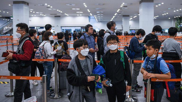 Passengers queue at immigration in Kuala Lumpur Airport