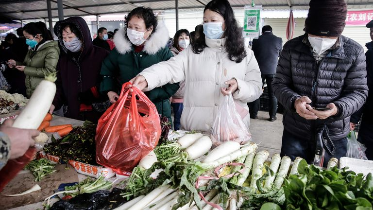 The resident wear masks to buy vegetables in the market on January 23, 2020 in Wuhan, Hubei¬China