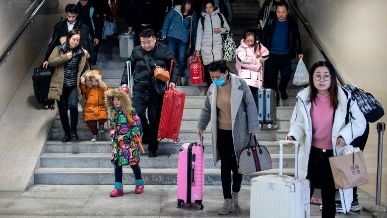 Passengers arrive in Beijing ahead of lunar new year celebrations