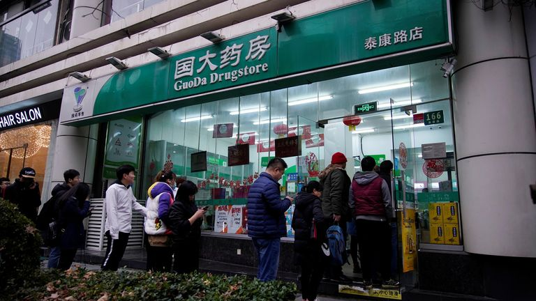 Long queues have formed outside pharmacies across China to buy facemasks