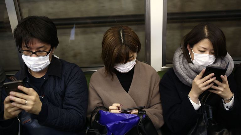 Passengers take measures to protect themselves in Tokyo