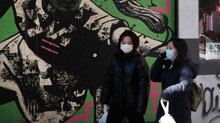 NEW YORK, NEW YORK - JANUARY 29: People wear medical face masks on the streets of Chinatown on January 29, 2020 in New York City. Sales of medical face masks have seen a sharp increase as fears of coronavirus grow and many retailers have sold out. The coronavirus, which originated in Wuhan, China, has now infected more than 6,150 people in more than a dozen countries. (Photo by Spencer Platt/Getty Images)