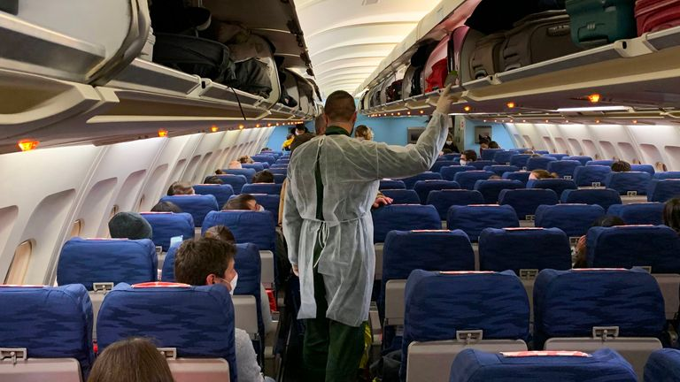 French citizens are seen sitting on a plane preparing to lave Wuhan Airport
