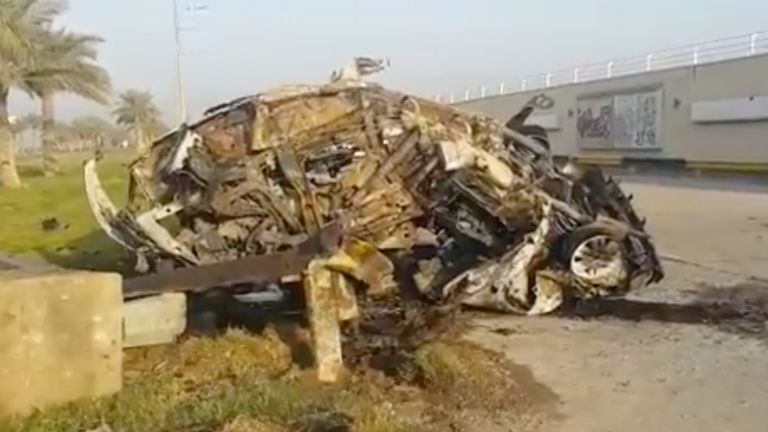 A damaged car, claimed to belong to Qassem Soleimani and Abu Mahdi al Muhandis, is seen near Baghdad airport