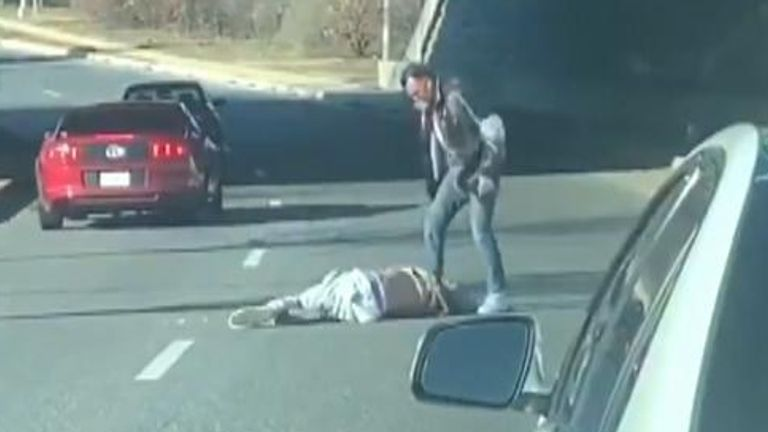 Delonte West lies on the road with his assailant standing over him Pic: kikithediva7