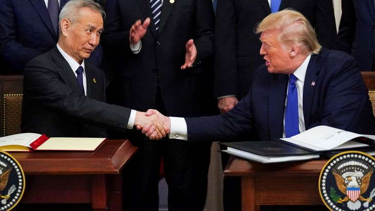 """Chinese Vice Premier Liu He and U.S. President Donald Trump shake hands after signing """"phase one"""" of the U.S.-China trade agreement during a ceremony in the East Room of the White House"""