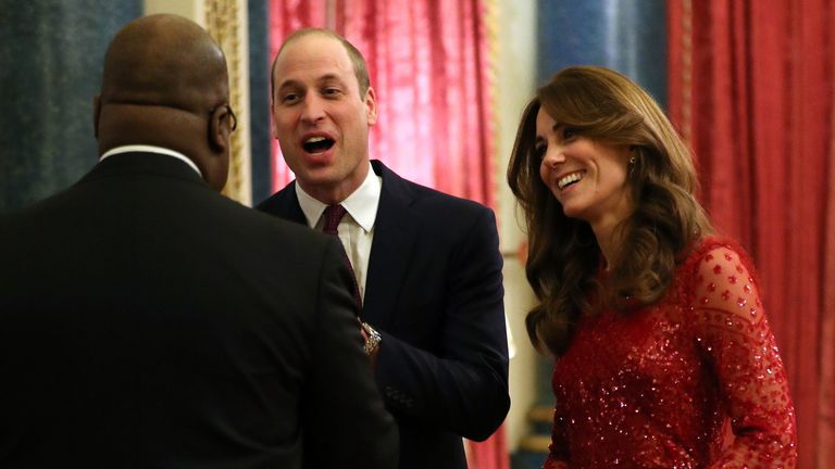 Duke and Duchess of Cambridge welcomes a guest to a reception at Buckingham Palace