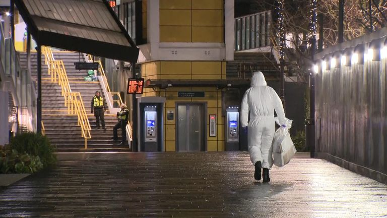A forensic officer near the scene where a young man was stabbed at East Croydon station