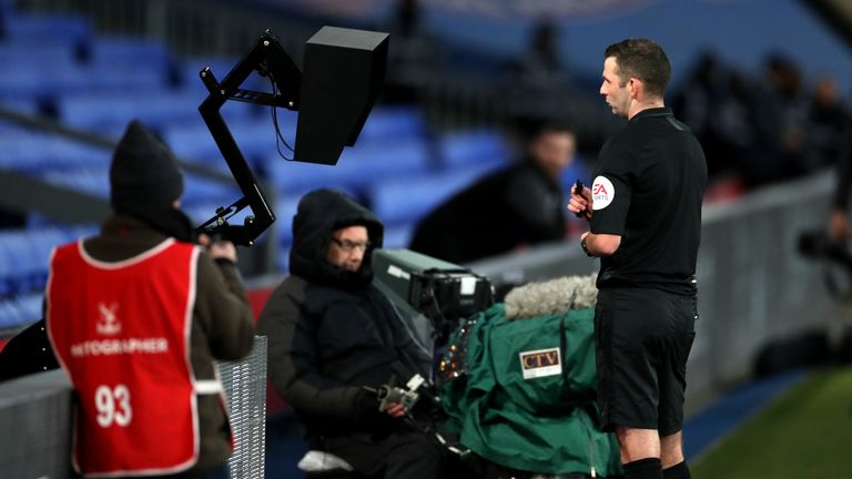 """Referee Michael Oliver checks the VAR during the FA Cup third round match at Selhurst Park, London. PA Photo. Picture date: Sunday January 5, 2020. See PA story SOCCER Palace. Photo credit should read: Bradley Collyer/PA Wire. RESTRICTIONS: EDITORIAL USE ONLY No use with unauthorised audio, video, data, fixture lists, club/league logos or """"live"""" services. Online in-match use limited to 120 images, no video emulation. No use in betting, games or single club/league/player publications."""