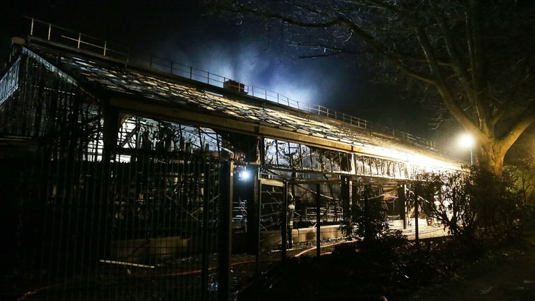 Firemen work at the burning monkey house of the zoo in Krefeld, western Germany, on early January 1, 2020. - Fire ripped through the monkey house at Krefeld zoo on New Year's Eve, killing dozens of animals, including orangutans, chimpanzees and marmosets, the management said. (Photo by Alexander FORSTREUTER / DPA / AFP) / Germany OUT (Photo by ALEXANDER FORSTREUTER/DPA/AFP via Getty Images)