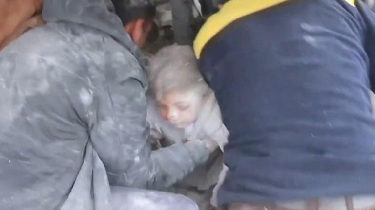 A girl was pulled out alive from the rubble of a collapsed building which had been hit by an air strike