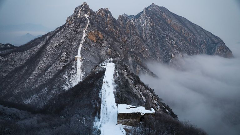 Tourists visit the Jiankou Great Wall covered in snow on December 16, 2019 in Beijing