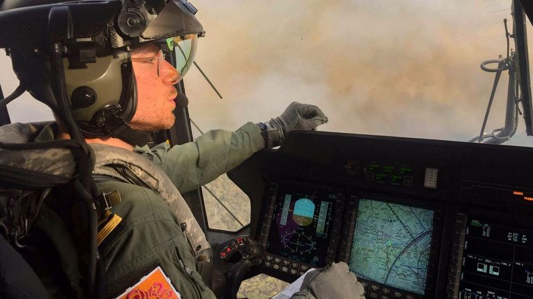 Lieutenant Commander Nick Grimmer is a British naval helicopter pilot flying rescue missions in the Australian bushfires. Pic: Royal Navy