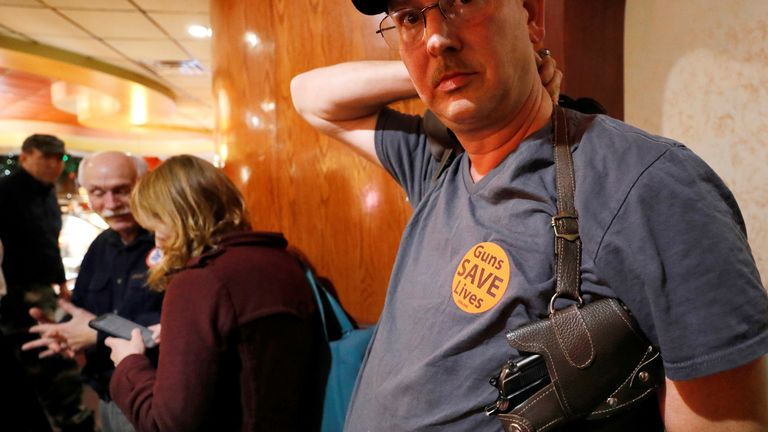 'Guns save lives', reads a pro-gun rights supporter's badge