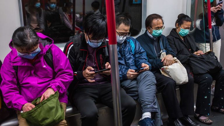 People wearing masks on a train on the first day of the Lunar New Year in Hong Kong