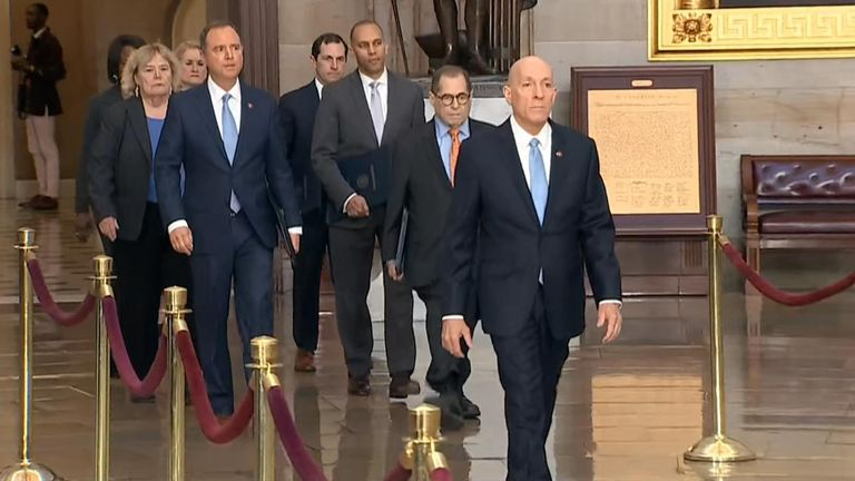 The managers, who will act as House prosecutors, walked across the hall to the Senate to read the impeachment articles out