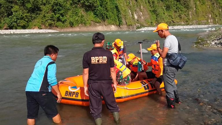 Rescuers using a rubber boat after the bridge collapse