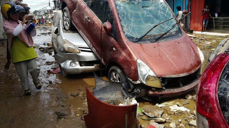 Destroyed cars in Bekasi, West Java after flooding triggered by heavy rain hit the area