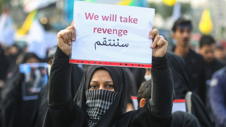 An Iraqi woman holds a placard during the funeral of Major General Qasem Soleimani and nine others