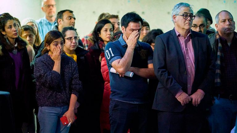 People attend a memorial service at Western University in London, Ontario, for the four graduate students who were killed in a plane crash in Iran