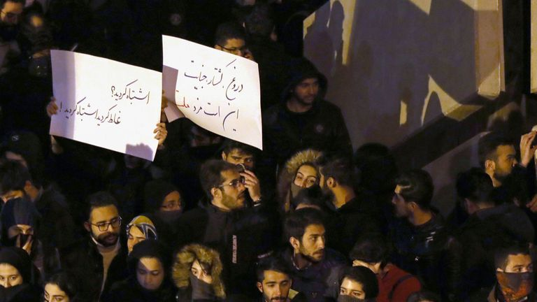 """Iranians students demonstrate following a tribute for the victims of Ukraine International Airlines Boeing 737 in front of the Amirkabir University in the capital Tehran, on January 11, 2020. - Iranian police dispersed students chanting """"radical"""" slogans during a gathering in Tehran to honour the 176 people killed when an airliner was mistakenly shot down, Fars news agency reported. AFP correspondents said hundreds of students had gathered early in the evening at Amir Kabir University, in downto"""