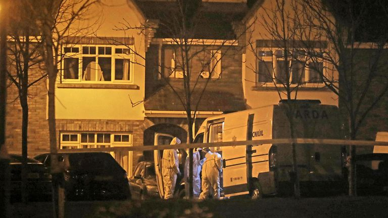 Garda at a house in the village of Newcastle, south west of Dublin, where three children have been found dead