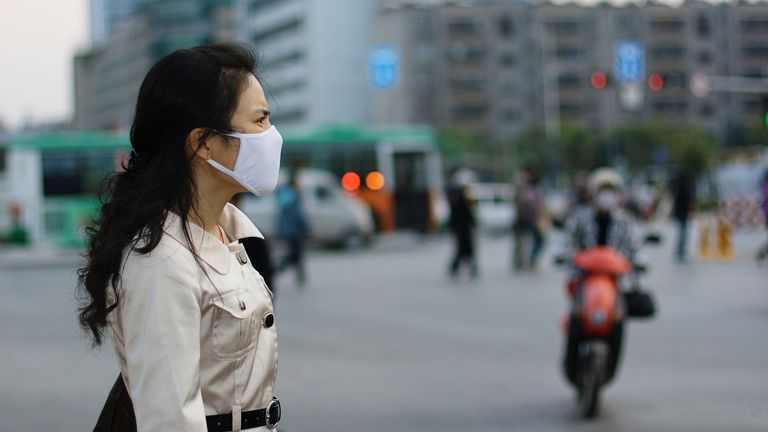 Woman wearing a face mask against pollution or disease stock photo