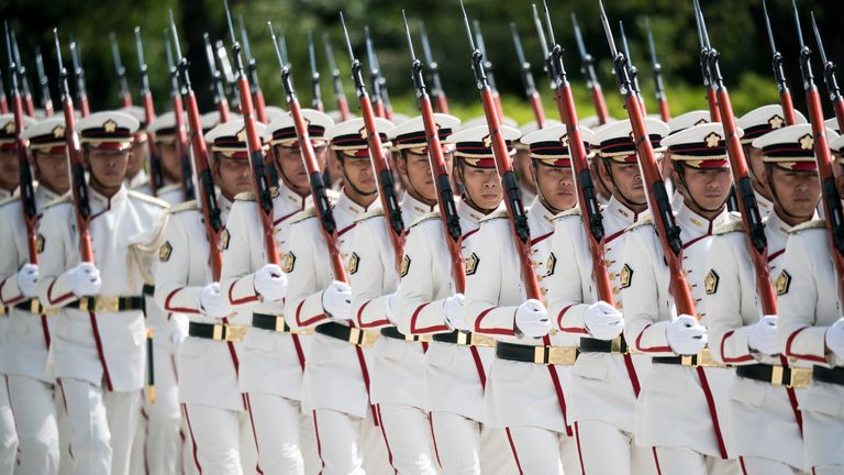 TOKYO, JAPAN - SEPTEMBER 17: A Japanese Self Defense Forces (SDF) honor guard marches before the inspection by Japan's Prime Minister Shinzo Abe at the Ministry of Defense on September 17, 2019 in Tokyo, Japan. Abe pledged Sunday, after reshuffling his cabinet, to push for a revision of the SDF stipulation in Article 9 of the Constitution. (Photo by Tomohiro Ohsumi/Getty Images)