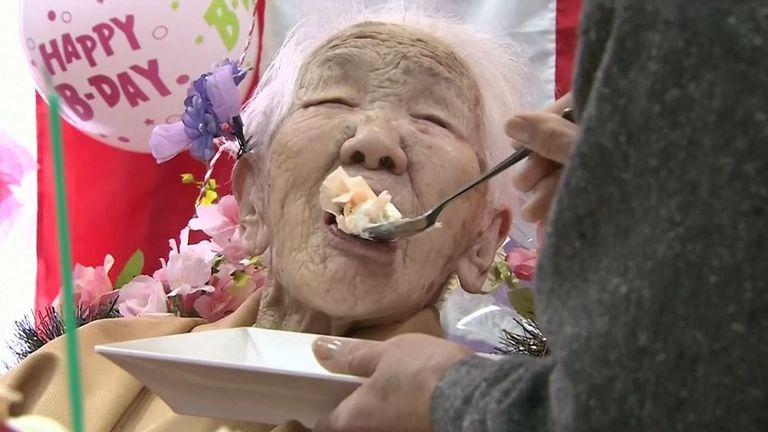 Ms Tanaka enjoys a mouthtful of birthday cake