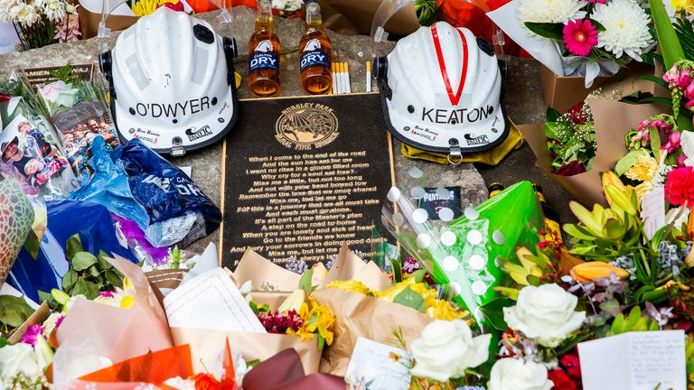 Tributes for volunteers Geoffrey Keaton and Andrew O'Dwyer are seen at Horsley Park Rural Fire Brigade on December 22, 2019 in Sydney, Australia