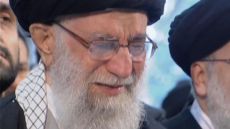 Iran's supreme leader Ayatollah Ali Khamenei appeared to cry as he prayed over the flag-draped coffins containing the remains of Qassem Soleimani and five others killed in the US strike.