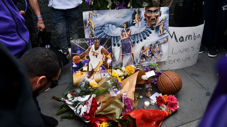 Fans mourn the loss of the NBA legend outside the Staples Center in Los Angeles