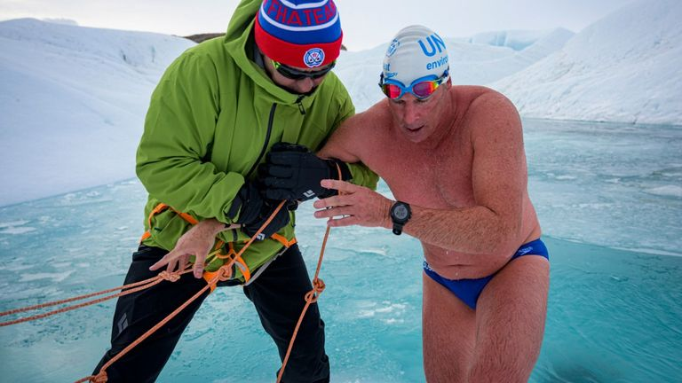 Lewis Pugh (right), alongside Slav Fetisov, as he successfully became the first person to swim under an Antarctic ice sheet