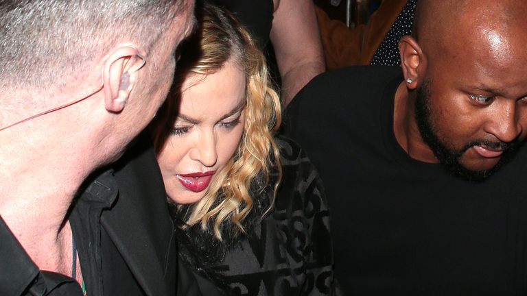 Madonna leaves the London Palladium surrounded by security