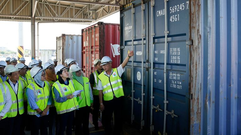 Malaysia's Environment Minister Yeo Bee Yin (third from left) inspects one of containers with plastic waste at a port