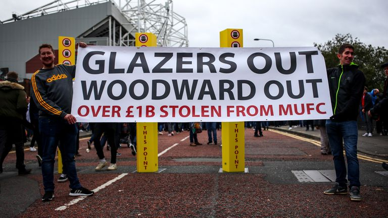 MANCHESTER, ENGLAND - OCTOBER 20: Fans of Manchester United protest against the owners of Manchester United, the Glazers and Chief Executive Ed Woodward prior to the Premier League match between Manchester United and Liverpool FC at Old Trafford on October 20, 2019 in Manchester, United Kingdom. (Photo by Robbie Jay Barratt - AMA/Getty Images)