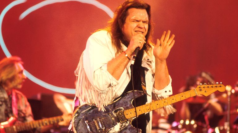 Meat Loaf performs on stage with John Entwistle of The Who, London, 1987