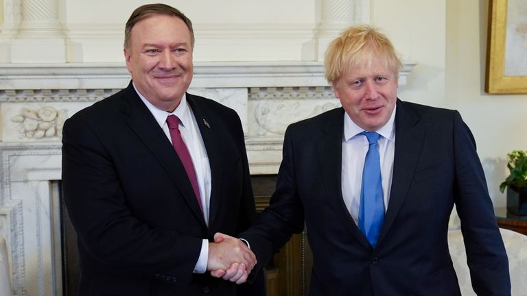 U.S. Secretary of State Mike Pompeo shakes hands with Boris Johnson as they meet at Downing Street