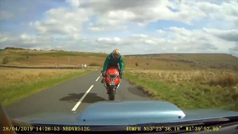 Dashcam footage shows the motorcyclist approaching a car prior to a crash