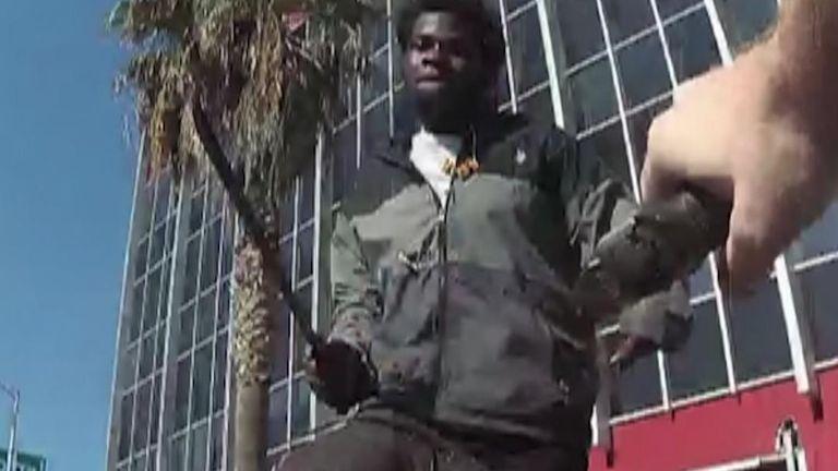 Machete-wielding attacker moments before he was shot