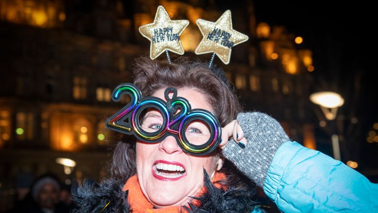 A woman parties through the night at the Hogmanay celebrations in Edinburgh