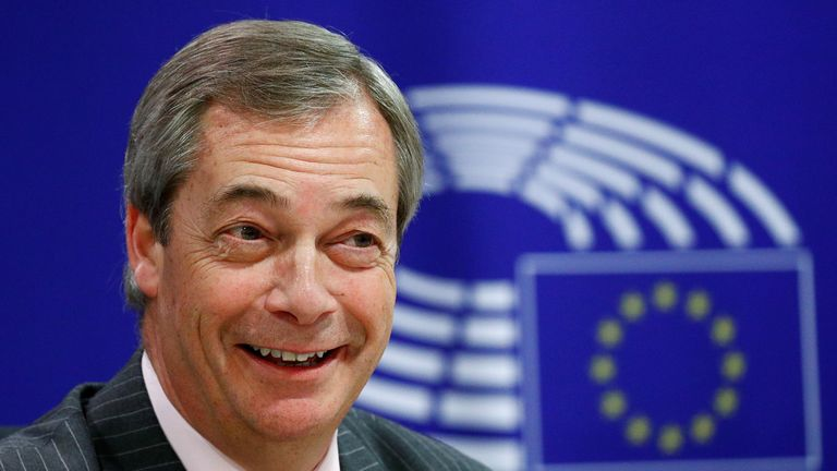 Brexit Party leader Nigel Farage reacts during a news conference ahead of a vote in the European Parliament on the Withdrawal Agreement in Brussels