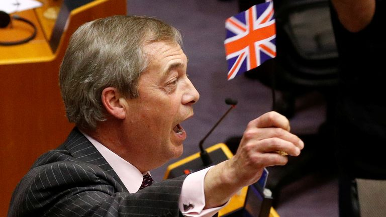 Nigel Farage waves a Union Jack while speaking in the European Parliament