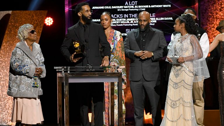 """Nipsey Hussle's grandmother Margaret Bouffe, Samiel Asghedom, Nipsey Hussle's sister Samantha Smith and Nipsey Hussle's daughter Emani Asghedom accept Best Rap Performance for """"Racks in the Middle"""" in honor of the late Nipsy Hussle onstage during the 62nd Annual GRAMMY Awards Premiere Ceremony at Microsoft Theater on January 26, 2020 in Los Angeles, California"""