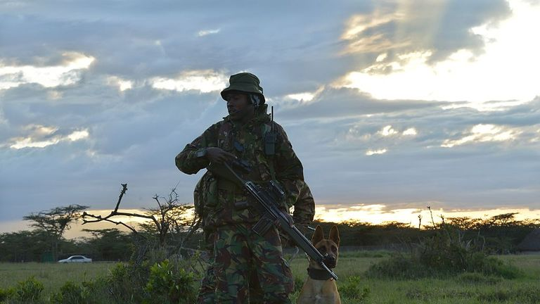 TO GO WITH AFP STORY BY NICOLAS DELAUNAY An elite anti-poaching unit embarks on an evening patrol on foot, on December 5, 2016, at the Ol Pejeta conservancy in Laikipia County -- at the foot of Mount Kenya -- that is home to the planet's last-three northern white rhinoceros. As 2016 draws to an end, awareness of the devastation of poaching is greater than ever and countries have turned to high-tech warfare -- drones, night-goggles and automatic weapons -- to stop increasingly armed poachers. Acc