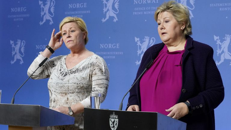 Populist Party leader Siv Jensen (L) has threatened to leave the coalition with prime minister Erna Solberg (R)