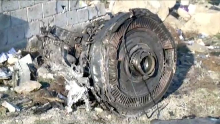 Plane engine among debris