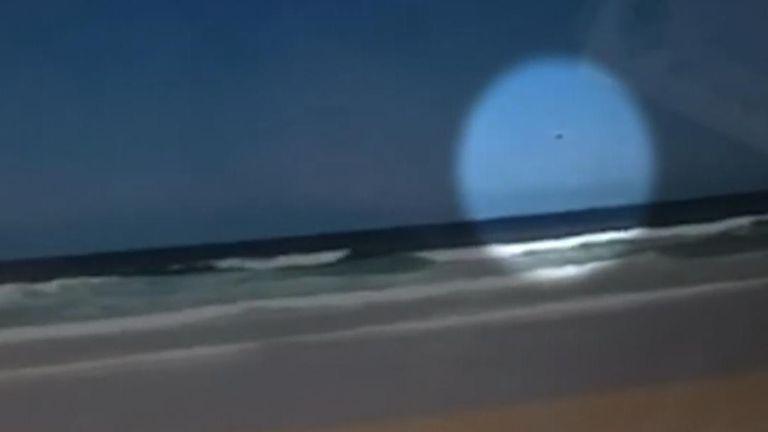 A light aircraft descends into the sea off Fraser Island