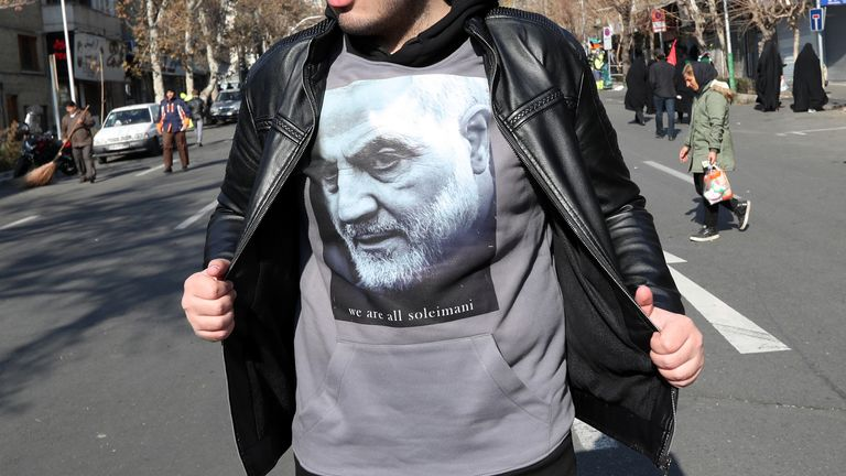 An Iranian boy wearing a t-shirt with an image of slain Iranian Revolutionary Guards Corps (IRGC) Lieutenant general and commander of the Quds Force Qaseem Soleimani